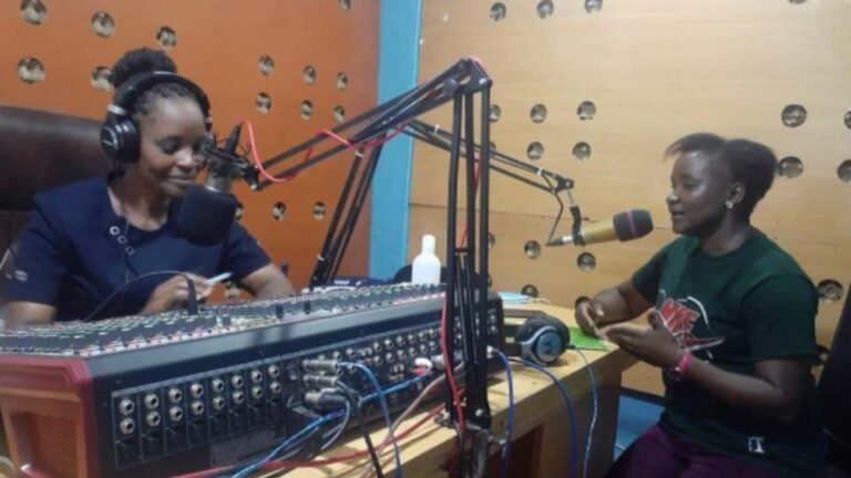 Director of Gender talks on the radio about where girls and women can go to get help, Migori County, Kenya